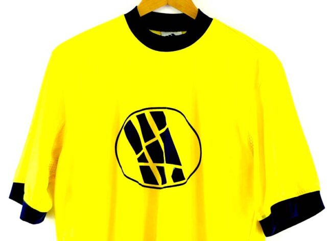 Close up of Yellow T Shirt Adidas