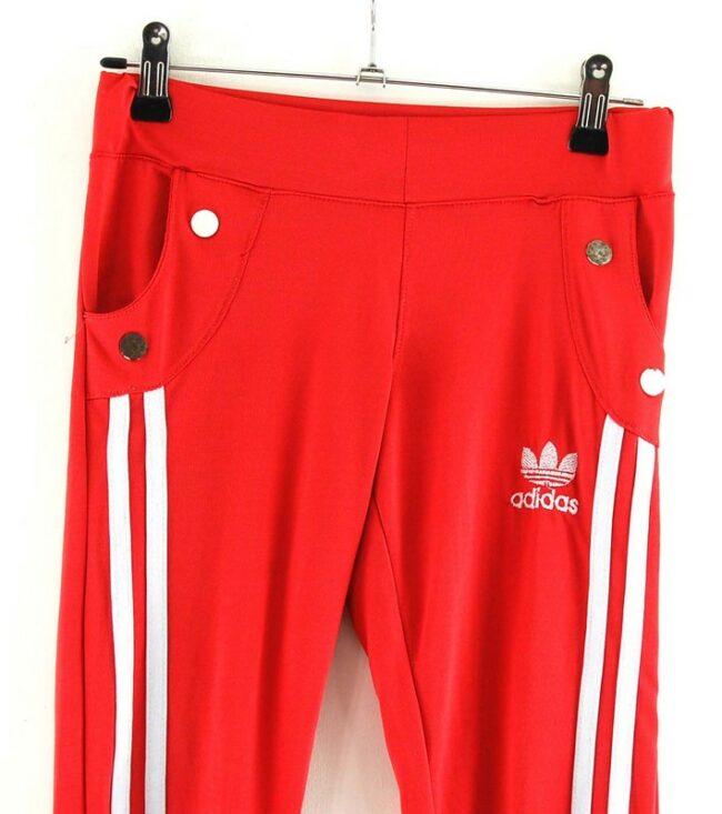 Close up of Red Adidas stripe Leggings
