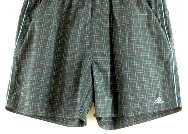 Close up of Adidas Check Shorts