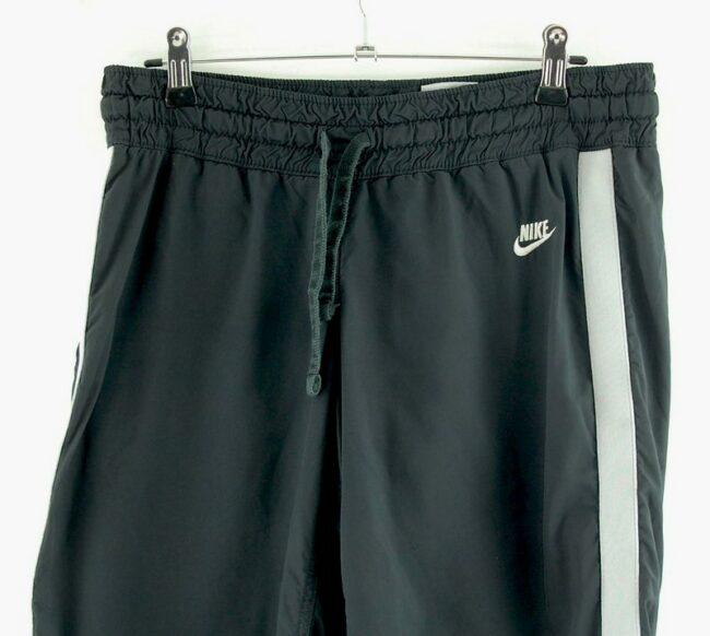 Close up of Black Nike Shorts With White Stripe