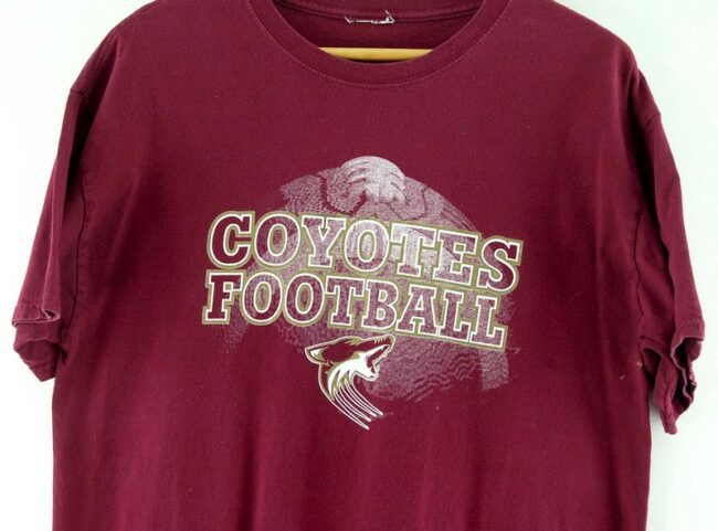 Close up of Maroon Coyotes Football Tee
