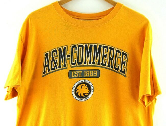 Close up of Yellow Texas A And M University Commerce T Shirt
