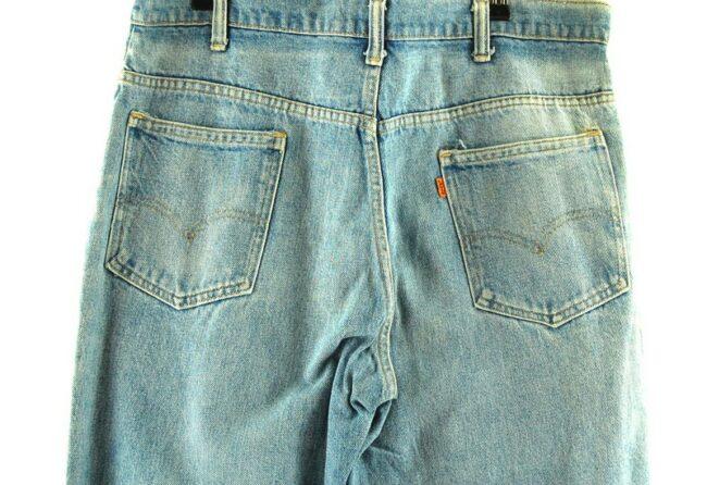 Back of 646 Bell Bottom Levi Distressed Denim Jeans