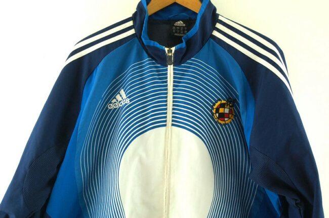 Close up of Blue Real Federacion Española De Futbol Adidas Training Top