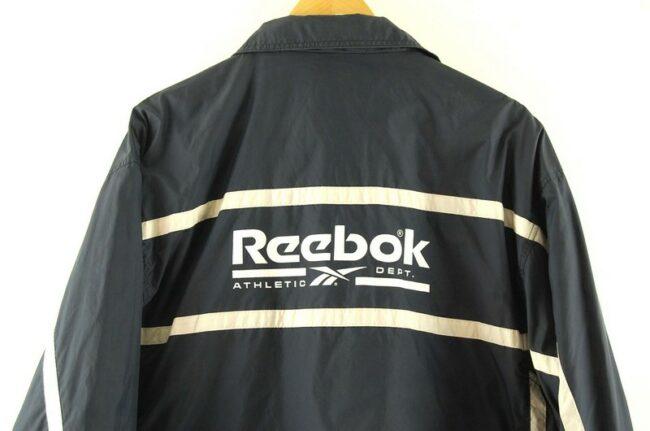 Back of Navy Reebok Athletic Department Jacket