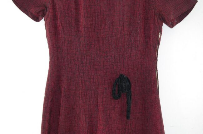Close up of Burgundy 1960s Pleated Dress with Bow