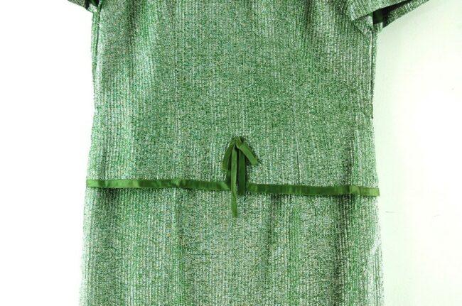 Close up of 1960s Metallic Green Shift Dress