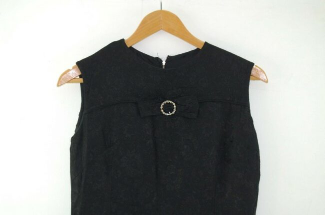 Front close up of 1960s Black Shift Dress with Bow