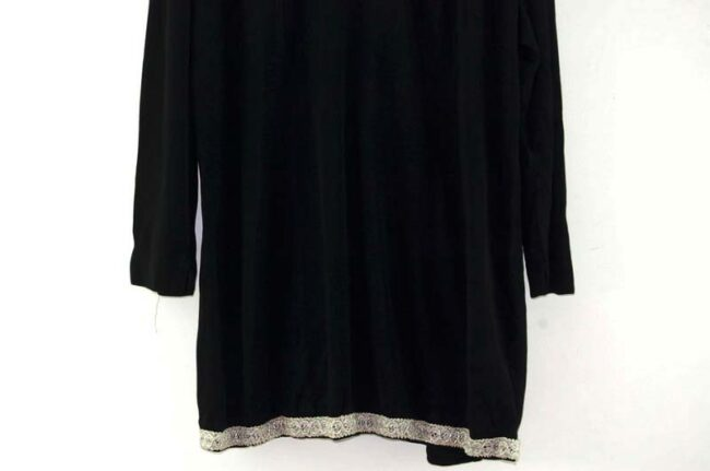 Close up of 1960s Black Dress With Silver Trim